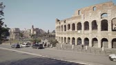 coliseum : ROME - FEB 20: Tourists passing by Roman Colosseum Coliseum Flavian Amphitheatre Anfiteatro Flavio Colosseo, February 20, 2018 People in Ancient Rome costumes. Locked down real time establishing shot Stock Footage