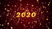 havai fişek : 2020 Greeting Card text with sparkling particles shiny background for Celebration,wishes,Events,Message,Holidays,Festival. Stok Video