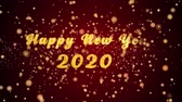 havai fişek : Happy New Year 2020 Greeting Card text with sparkling particles shiny background for Celebration,wishes,Events,Message,Holidays,Festival. Stok Video