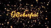 баварский : Oktoberfest Abstract particles and fireworks greeting card text with shiny black background for festivals,events,holidays,party,celebration.