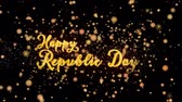 szafran : Happy Republic Day Abstract particles and fireworks greeting card text with shiny black background for festivals,events,holidays,party,celebration. Wideo