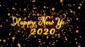Happy New Year 2020 Abstract particles and fireworks greeting card text with shiny black background for festivals,events,holidays,party,celebration. Stok Video