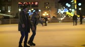 People ride on ice rink
