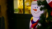 Wooden snowman and christmas tree at the door Stock Footage