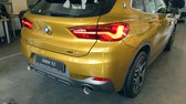 motor show : gold BMW x2 2018 In dealer salon 08.10.2108 Lviv Ukraine Stock Footage