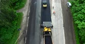 steamroller : Road construction workers with paving machine. Shooting drone Stock Footage