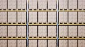 distribution : Large metal yellow shelves, pallets with cardboard boxes in modern warehouse interior. 60 fps animation. Stock Footage