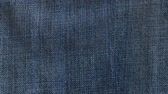 Jeans fabric waving cloth moving animated seamless loop background Stok Video
