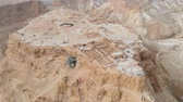 jordanie : Soaring aerial 4K view MASADA, ISRAEL. Filmed flying drone. flying around Masada, an ancient Jewish fortress in the Israeli desert. Israeli soldiers on top of the mountain. Stockvideo