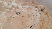 Masada - Aerial footage of the ancient fortification in the Southern District of Israel. Israeli soldiers on top of the mountain. Moving forward. Flying over masada. The view from the top. 4k Videos