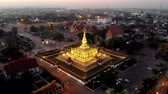 history : Pha That Luang is a gold-covered large Buddhist stupa and be most important national monument in Laos and a national symbol. Vientiane, Laos.