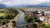 Bamboo bridge over Nam Song River at Vang Vieng village, Laos. Top view of city. Urban landscape. Beautiful nature of Asia. 動画素材