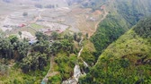 Aerial view of green terraced rice fields and building on the valley at Cat Cat village in Sapa, 4K move flying drone 動画素材