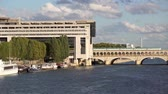 административное здание : Metro crossing Bercy bridge with French Ministry for Economy and Finance - Paris, France Стоковые видеозаписи