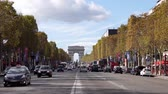 France, Paris - September 24, 2018: Traffic on Champs-Elysees with Arc de Triomphe in background Stock Footage