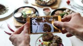 Hands taking photo various dishes with smartphone Dostupné videozáznamy