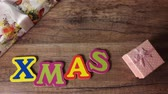 Xmas on a wooden table with gifts, Stop motion, top view shot Vídeos