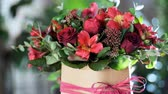 frezja : Flower bouquet in the rays of light, rotation, the floral composition consists of Alstroemeria, Rose prestige, Brunia green, solidago, eucalyptus, Rose pion-shaped bordeaux