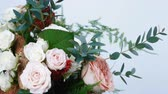 frezja : close-up, Flower bouquet in rotation on white background, consists of Rose cappuccino, Snowflake rose, Rose yana creamy, Plamosus, eucalyptus, solidago, Rose of avalanche.