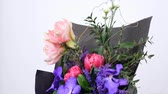 frezja : Flowers, bouquet, rotation on white background, floral composition consists of Eustoma, eucalyptus, Amaryllis pink, Orchid vanda, Tulip piano, solidago Wideo