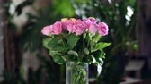 frezja : Flower bouquet in the rays of light, rotation, the floral composition consists of pink and orange Rose aqua. in the background a lot of greenery. Divine beauty Wideo