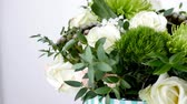 parfém : close-up, Flowers, bouquet, rotation on white background, floral composition consists of Brunia green, Rose of avalanche, Rose yana creamy, Santini , gypsophila,