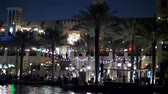 souk : DUBAI, UNITED ARAB EMIRATES, UAE - NOVEMBER 20, 2017:Hotel Jumeirah Al Qasr Madinat ,night walk along the water canal, on a boat. The lanterns illuminate the buildings