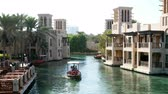 souk : DUBAI, UNITED ARAB EMIRATES, UAE - NOVEMBER 20, 2017:Hotel Jumeirah Al Qasr Madinat ,day walk along the water canal, by boat. Stock Footage