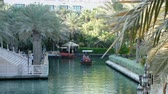 madinat : DUBAI, UNITED ARAB EMIRATES, UAE - NOVEMBER 20, 2017: Hotel Jumeirah Al Qasr Madinat ,day Arba boat trip on the water canal in the hotel complex.