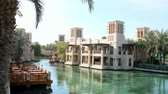 souk : DUBAI, UNITED ARAB EMIRATES, UAE - NOVEMBER 20, 2017: Hotel Jumeirah Al Qasr Madinat ,day Arba boat trip on the water canal in the hotel complex.