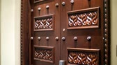 souk : DUBAI, UNITED ARAB EMIRATES, UAE - NOVEMBER 20, 2017: Hotel Jumeirah Al Qasr Madinat , beautiful carved wooden doors in a hotel room, close up