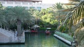madinat : DUBAI, UNITED ARAB EMIRATES, UAE - NOVEMBER 20, 2017: Hotel Jumeirah Madinat ,day Arba boat trip on the water canal in the hotel complex. family vocation