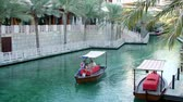 souk : DUBAI, UNITED ARAB EMIRATES, UAE - NOVEMBER 20, 2017: Hotel Jumeirah Madinat ,day Arba boat trip on the water canal in the hotel complex. family vocation