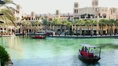 souk : DUBAI, UNITED ARAB EMIRATES, UAE - NOVEMBER 20, 2017: Hotel Jumeirah Madinat , near Burj al Arab. day Arba boat trip on the water canal in the hotel complex. family vocation