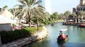 madinat : DUBAI, UNITED ARAB EMIRATES, UAE - NOVEMBER 20, 2017: Hotel Jumeirah Madinat , near Burj al Arab. day Arba boat trip on the water canal in the hotel complex. family vocation