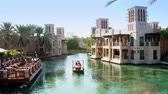 madinat : DUBAI, UNITED ARAB EMIRATES, UAE - NOVEMBER 20, 2017: Hotel Jumeirah Madinat ,day Arba boat trip on the water canal , in the sunlight, in the hotel complex. family vocation