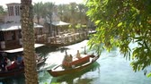 souk : DUBAI, UNITED ARAB EMIRATES, UAE - NOVEMBER 20, 2017: Hotel Jumeirah Madinat ,day Arba boats trips on the water canal , in the sunlight, in the hotel complex. family vocation