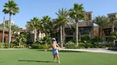souk : DUBAI, UNITED ARAB EMIRATES, UAE - NOVEMBER 20, 2017: Hotel Jumeirah Al Qasr Madinat, near Burj al Arab. little boy running happily on a green lawn