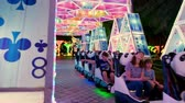 recyclable : DUBAI, UNITED ARAB EMIRATES, UAE - NOVEMBER 20, 2017: Dubai Garden Glow park , at night. entertainment, a steam locomotive for children travels along luminous tunnels