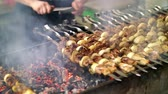 kuzu : Grilled kebab cooking on metal skewer close up. Roasted meat cooked at barbecue. Grill on charcoal and flame, picnic, street food