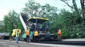 obnova : CHERKASSY REGION, UKRAINE - MAY 31, 2018: repair of a highway, Road construction works. workers lay asphalt. There are lots of special equipment, machines for paving asphalt