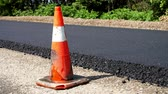 sinal de alerta : Traffic Cone on road. Road construction works , road repair. On the road there is fresh asphalt laid on one side of the traffic. Construction and repair of highway