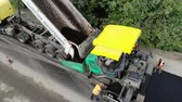 operador : CHERKASSY REGION, UKRAINE - MAY 31, 2018: Aerial view on repair of a highway, the process of laying a new asphalt covering, Road construction works.