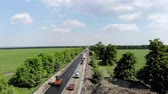 steamroller : CHERKASSY REGION, UKRAINE - MAY 31, 2018: Aerial view on repair of a highway, the process of laying a new asphalt covering, Road construction works.