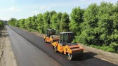 paver : CHERKASSY REGION, UKRAINE - MAY 31, 2018: Aerial view on repair of a highway, the process of laying a new asphalt covering, Road construction works.