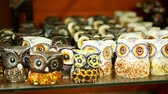 souk : HURGHADA, EGYPT - OCTOBER 24, 2018: close-up, various souvenirs made of stone, wood, glass and metal, in the gift shop for tourists. Stock Footage