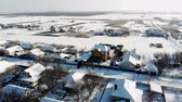 alfândega : CHERKASY REGION, UKRAINE, DECEMBER 25, 2018: winter, snow-covered streets, houses. frosty sunny day. aero, view from above. Vídeos