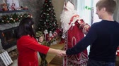 ült : CHERKASY REGION, UKRAINE, DECEMBER 25, 2018: family new year, christmas. family with small children dressed in Christmas costumes. Santa Claus visits children. they have fun together, get presents