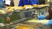 caixa : close-up, showcase with dishes in modern Self service canteen, cafeteria, mess hall, factory employees having lunch in the canteen, they are Served Meal In factory Canteen