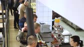 self service : CHERKASY, UKRAINE, FEBRUARY 20, 2019: showcase with dishes in modern canteen, cafeteria, mess hall. factory employees having lunch in the canteen, people are Served Meals In factory Canteen. Filmati Stock